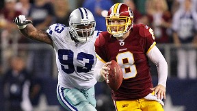 Anthony Spencer runs down Redskins quarterback Rex Grossman before stripping him of the ball. Cowboys LB Sean Lee recovered, clinching the 18-16 victory.