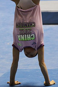 The Chinese team's confidence is not in doubt -- the gymnasts showed up to training wearing these China 2012 Champion shirts.