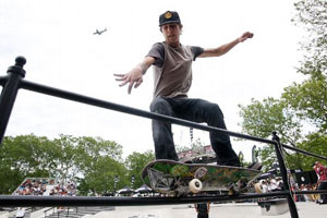 Despite a bad crop, David Gravette grinds the lower rung during the NYC Maloof Money Cup contest.