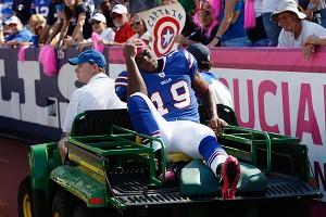 AP Photo/David Duprey Buffalo receiver Donald Jones is carted off the