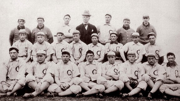 A team photo of the 1906 Chicago White Sox shows star pitcher Ed Walsh, who won two of the four games, seated in the front row, far left, while team owner Charlie Comiskey is standing in street clothes.