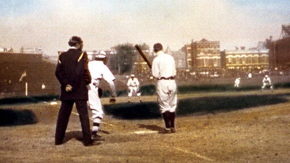 Tigers star Ty Cobb stands at the plate during the 1907 World Series in Chicago. Johnny Kling is the Cubs' catcher, and Cubs shortstop Joe Tinker is shown in the right portion of the photo.