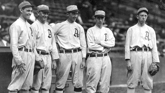 The Athletics' '$100,000 Infield' -- Stuffy McInnis, left, Danny Murphy, Frank 'Home Run' Baker, Jack Barry and Eddie Collins -- poses together at Philadelphia's Shibe Park in 1911.