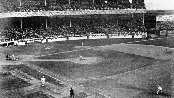 In this wide-angle shot of the Polo Grounds, the Giants' Rube Marquard throws the first pitch of the World Series to the Athletics' Eddie Murphy.