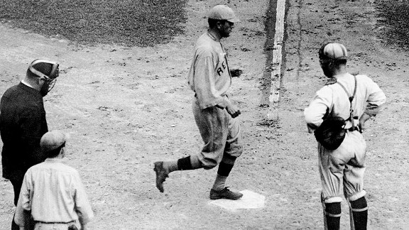 Red Sox right fielder Harry Hooper steps on home plate after his eventual game-winning home run in Game 5 of the 1915 World Series.