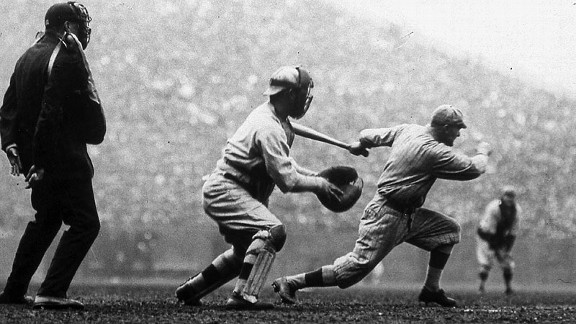 Robins outfielder Hy Myers strokes an inside-the-park home run during the first inning of Game 2 of the 1916 World Series.