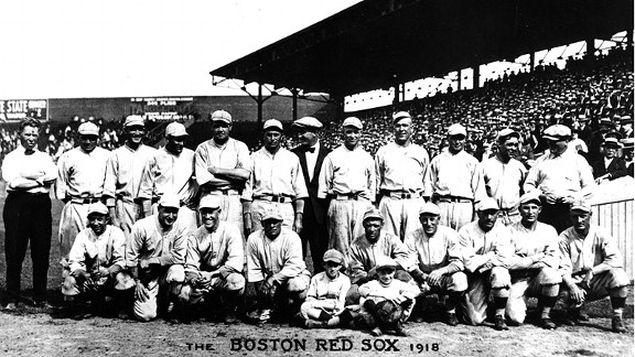 This is a 1918 team photo of the Boston Red Sox, whom locals questioned because they were on a baseball field instead of a battlefield.