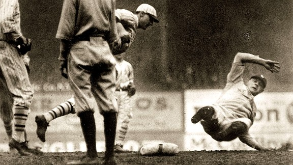 Babe Ruth, right, is out during a rundown between first and second during Game 2. He was tagged out by the Giants' George Kelly, third from left, with Dave Bancroft, far left, watching the play.