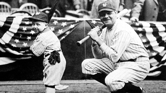 Babe Ruth poses with New York Yankee mascot, Ray Kelly, before the start of the World Series at Yankee Stadium in 1923.
