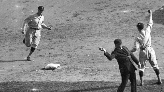 Goose Goslin rounds third base after hitting a three-run homer in the third inning of Game 4 of the 1924 World Series.