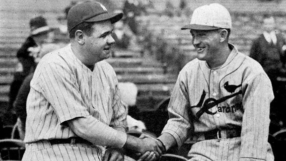 Yankees star Babe Ruth shakes hands with Cardinals star Rogers Hornsby before the start of the 1926 World Series.
