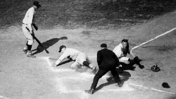 Yankees first baseman Lou Gehrig slides home safely as Pirates catcher Johnny Gooch tries to make the play during Game 2 of 1927 World Series.