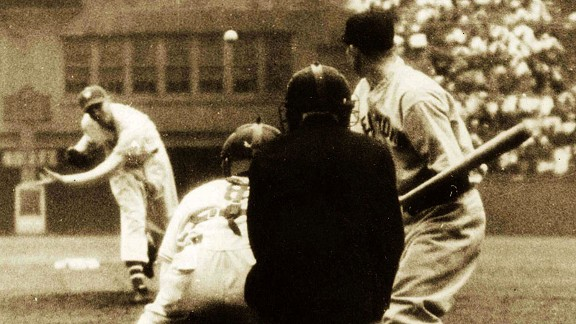 Giants left-hander Carl Hubbell delivers a pitch to the Yankees' Bill Dickey during Game 1 of the 1937 World Series.