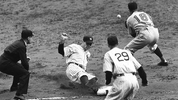 Yankees outfielder Charlie Keller slides into third base with triple as Reds third baseman Billy Werber fields the throw in Game 1 of the 1939 World Series.