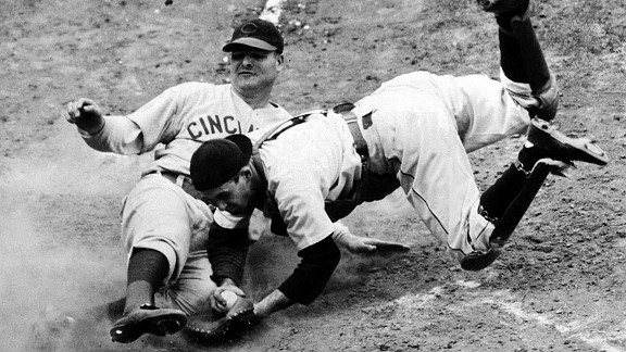 The Reds' Bill Baker slides in safely at home as Tigers catcher Birdie Tebbetts tries to apply the tag in Game 3 of the 1940 World Series.