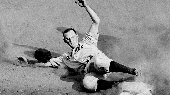 Yankees second baseman Joe Gordon slides into third base with a triple during Game 3 of the 1941 World Series.