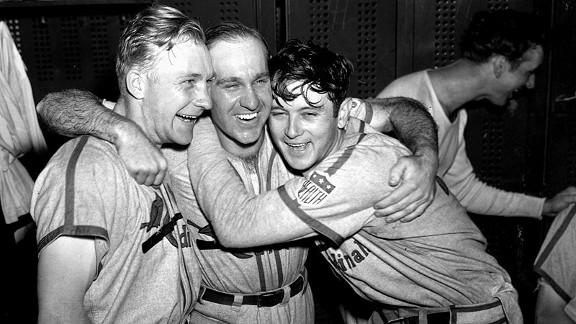 Cardinals players Whitey Kurowski, left, Enos Slaughter and Johnny Beazley celebrate after winning Game 5 to clinch the 1942 World Series title.