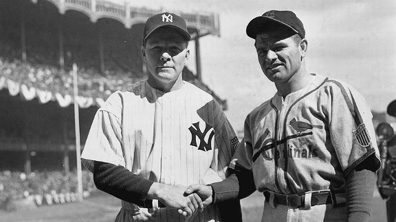 Starting pitchers Spud Chandler of the Yankees and Max Lanier of the Cardinals shake hands before Game 1 of the 1943 World Series.