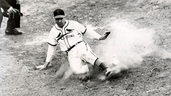 Cardinals outfielder Enos Slaughter slides home with the winning run in Game 7 of the 1946 World Series.