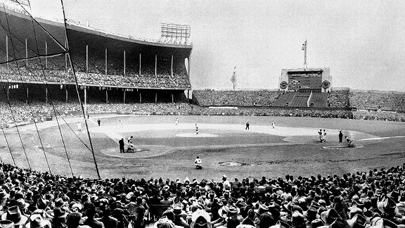 This is a panoramic view of Municipal Stadium in Cleveland as the largest crowd in baseball history (86,288) watches Game 5 of the 1948 World Series. Joe Gordon is at bat for the Indians.