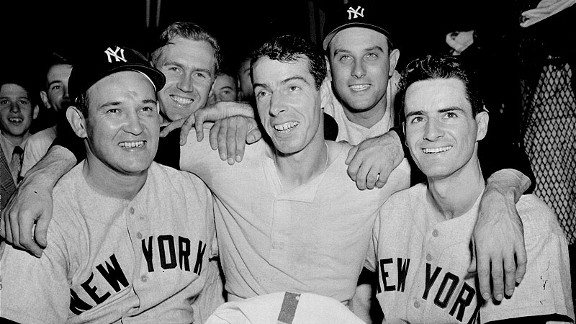 Joe DiMaggio is flanked by Yankee teammates after his 10th inning home run beat the Phillies in Game 2 of the 1950 World Series. The other teammates are Allie Reynolds, left, Bobby Brown, Gene Woodling and Gerry Coleman.