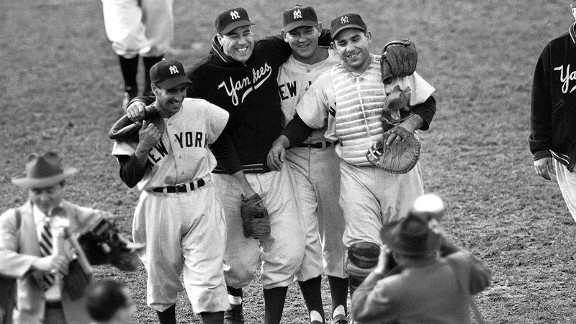 Allie Reynolds, second from right, is escorted from the field by his happy teammates after he pitched the Yankees to a victory in Game 4 of the 1951 World Series.