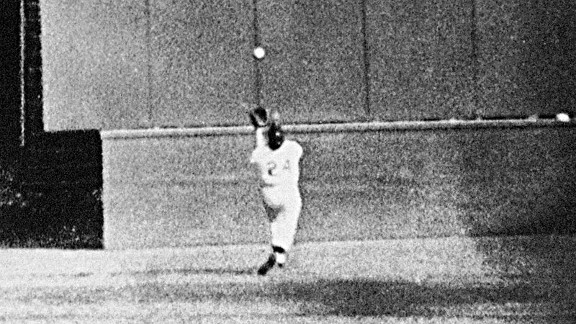 One of baseball's signature photos: Willie Mays, running at top speed with his back to the plate, gets under a 450-foot blast off from the Indians' Vic Wertz to catch it in front of the center-field wall in the eighth inning of Game 1 at the Polo Grounds.