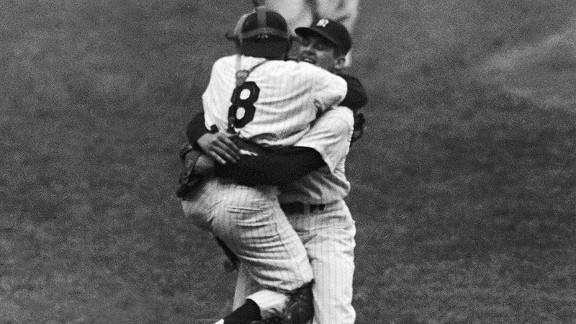 Yankees catcher Yogi Berra leaps into the arms of pitcher Don Larsen after Larsen struck out the last Dodgers batter to complete his perfect game during the Game 5 of the 1956 World Series.