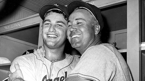 Dodgers pitcher Larry Sherry, left, and center fielder Duke Snider embrace in the dressing room after the Dodgers defeated the White Sox to win the 1959 World Series.