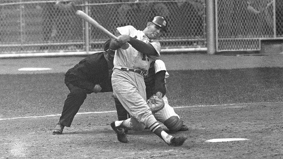 Cardinals catcher Tim McCarver follows through on his game-winning three-run homer in the 10th inning of Game 5 of the 1964 World Series.