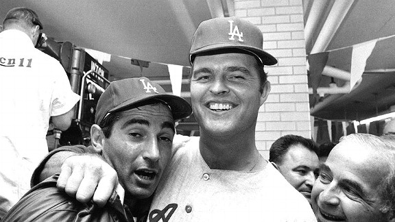 Dodgers pitchers Sandy Koufax, left, and Don Drysdale celebrate after defeating the Twins in the 1965 World Series.