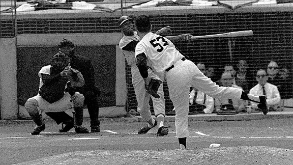 Baltimore Orioles slugger Frank Robinson hits a home run in the 1966 World Series