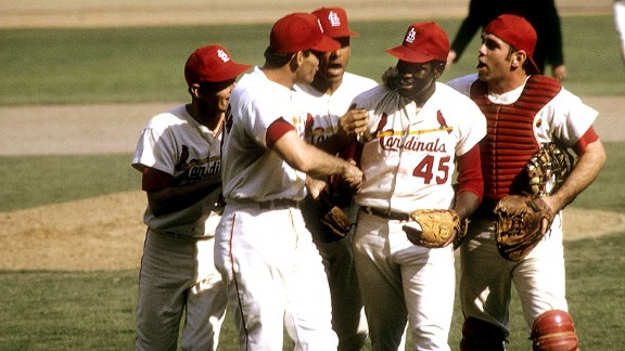 Cardinals ace Bob Gibson is congratulated by his teammates after his complete-game victory over the Red Sox in Game 4 of the 1967 World Series.