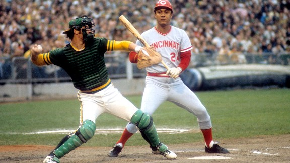 With the Reds' Tony Perez batting, A's catcher Gene Tenace fires a ball to second base during the 1972 World Series.