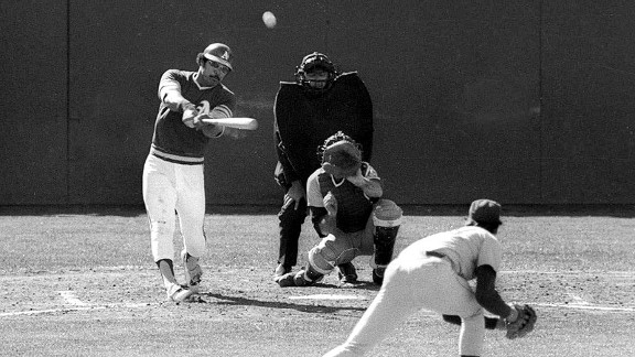 A's slugger Reggie Jackson slams a third-inning home run off Mets pitcher Jon Matlack during Game 7 of the 1973 World Series.