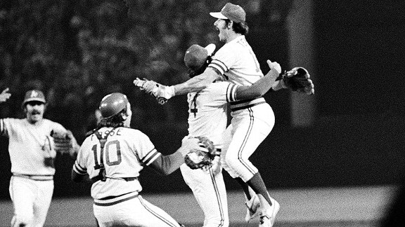 Gene Tenace, right, embraces A's relief ace Rollie Fingers as catcher Ray Rosse, left, comes in to join the jubilation after Oakland beat the Dodgers in Game 5 of the 1974 World Series.