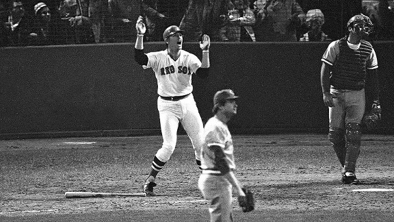 As Reds catcher Johnny Bench and pitcher Pat Darcy watch, Carlton Fisk slams a 12th-inning home run to win an epic Game 6 of the 1975 World Series for Boston.