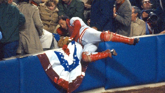 Reds catcher Johnny Bench goes into the stands to catch a foul ball during Game 4 of the 1976 World Series.
