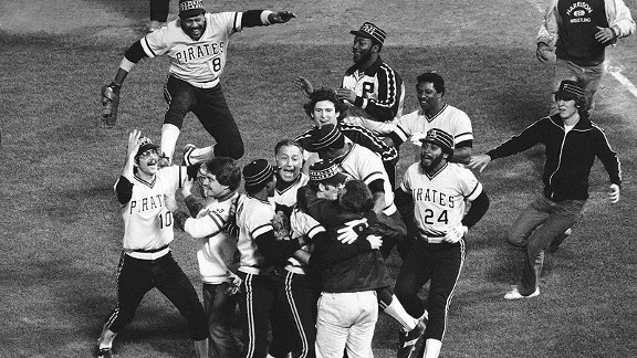 The Pirates mob relief pitcher Kent Tekulve, lower right center, as Willie Stargell (8) and Tim Foli (10) and Mike Easler (24) rush forward to join the group after winning the 1979 World Series.