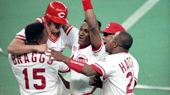 Glenn Braggs, left, Billy Bates, Eric Davis, Jose Rijo and Billy Hatcher, right, celebrate after the Reds beat the A's in the 10th inning of Game 2 of the 1990 World Series.