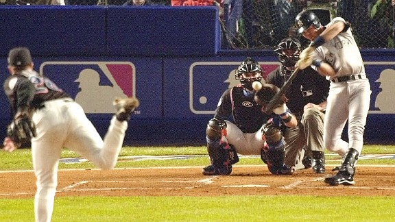Yankees shortstop Derek Jeter hits a leadoff home run off Mets pitcher Bobby Jones in the first inning of Game 4 of the 2000 World Series.
