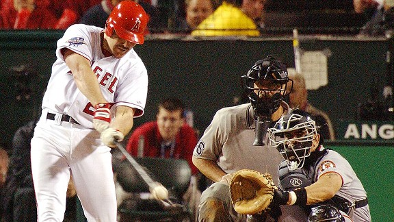 The Angels' Scott Spiezio hits a clutch three-run home run during Game 6 of the 2002 World Series against the Giants.