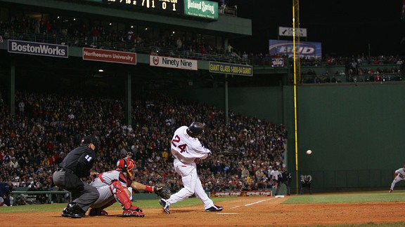 Red Sox left fielder Manny Ramirez hits an RBI single in the seventh inning of Game 1 of the 2004 World Series.