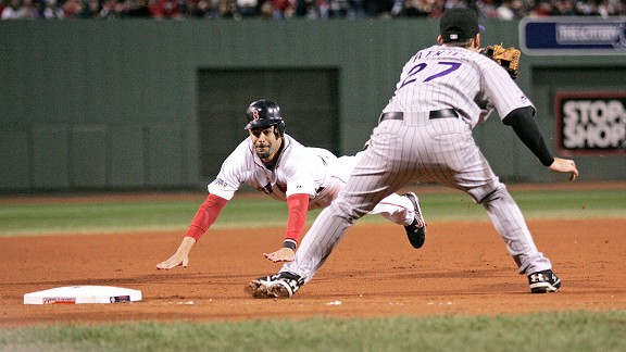 Boston's Mike Lowell dives into third base as Rockies third baseman Garrett Atkins awaits the throw in Game 2 of the 2007 World Series.