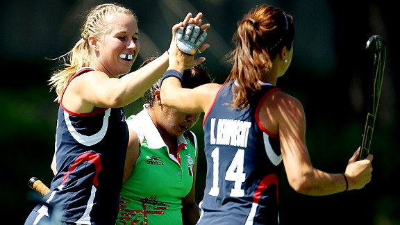USA field hockey player Shannon Taylor high fives Katherine Reinprecht during their 5-0 win against Mexico at the Pan Am Games.