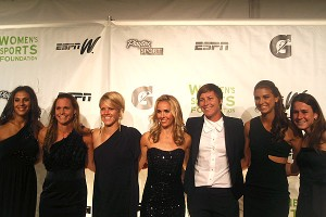 Teammates line up with U.S. women's soccer star Abby Wambach, third from right, as she is named WSF Sportswoman of the Year for a team sport.