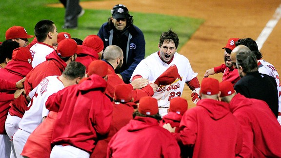 David Freese gets ready to celebrate with his Cardinals teammates after hitting a walk-off home run in the 11th inning of Game 6.