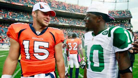 Tim Tebow and Santonio Holmes