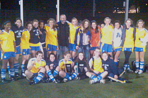 The Saint Ann's soccer team shows off its hardware after winning the AAIS league title.