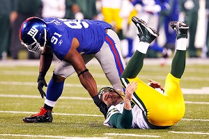 Justin Tuck and Aaron Rodgers